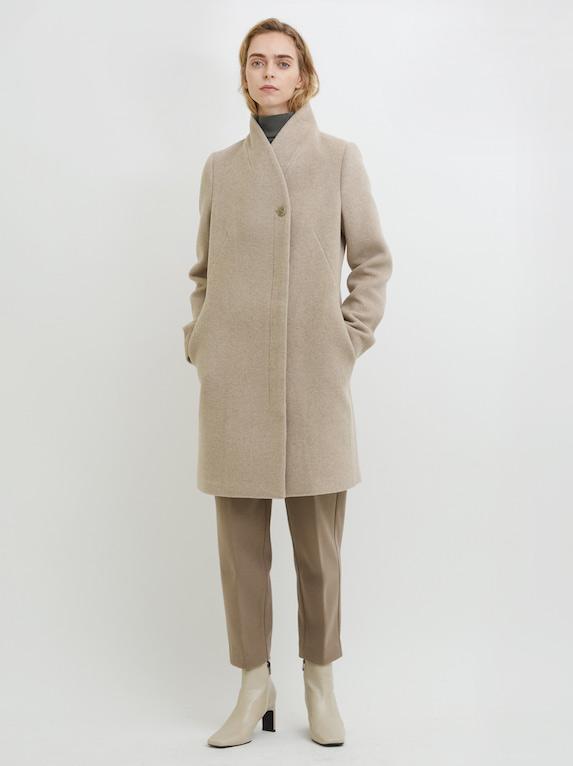 Model wears beige-coloured cocoon coat