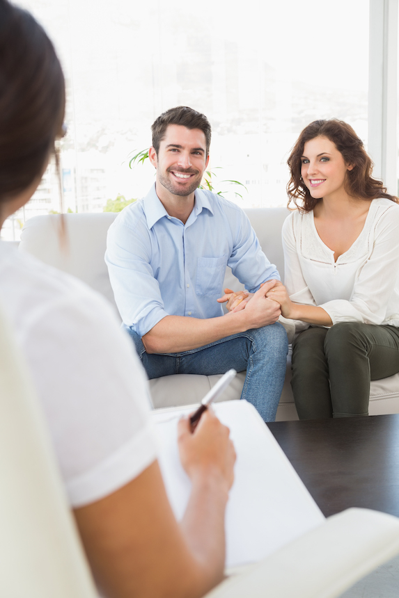 Enthusiastic couple participating in couple's therapy