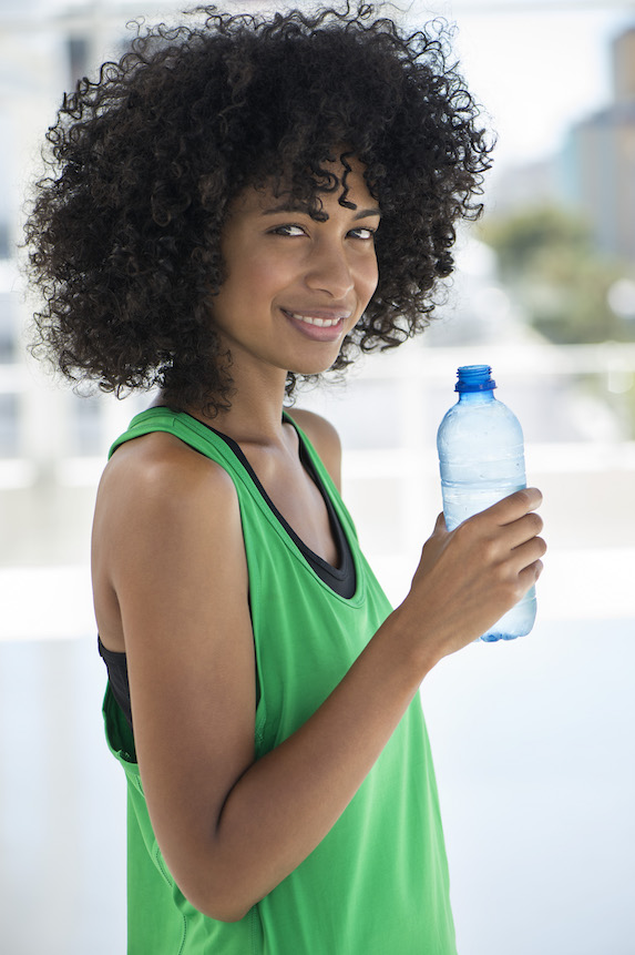 Woman holds a water bottle