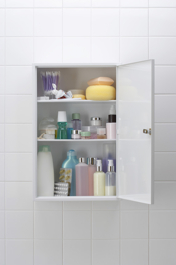 Organized bathroom cabinet with beauty products and cosmetics