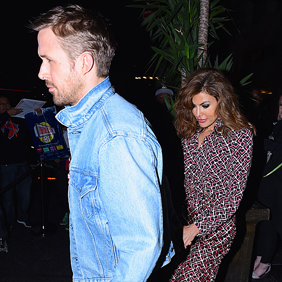 Ryan Gosling and Eva Mendes walking to SNL after-party