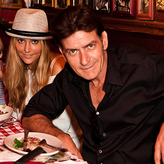 Brooke Mueller and Charlie Sheen at birthday dinner in 2011