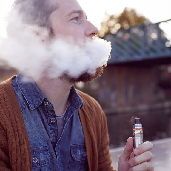 a young man vaping