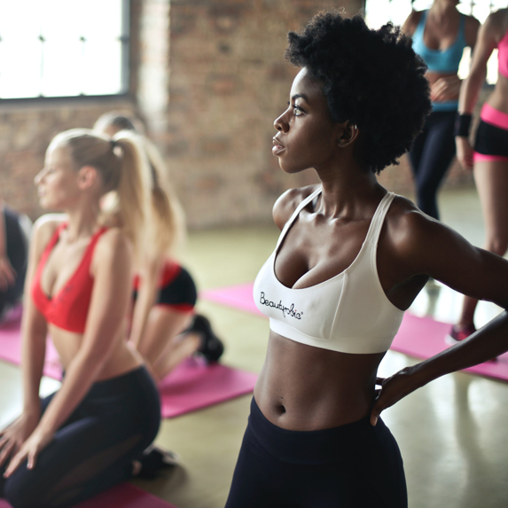 Athletic women in sports bras at a workout class
