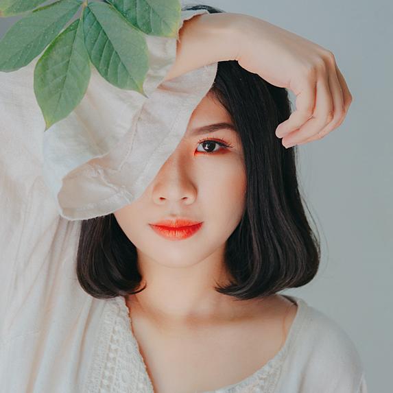Woman with bright orange lip tint