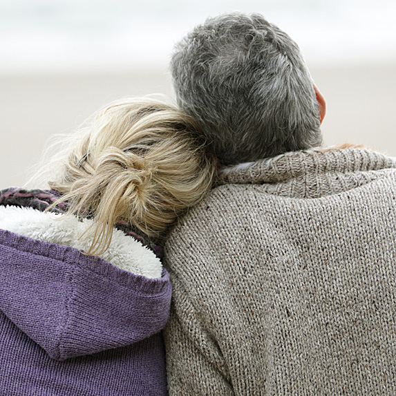 Back of woman's head leaning on man's shoulder