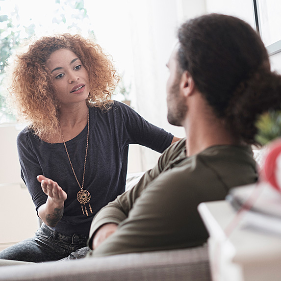 Woman and man having a serious discussion