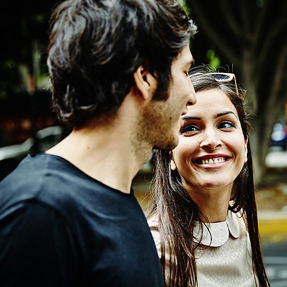 Woman looking at man adoringly during easy conversation