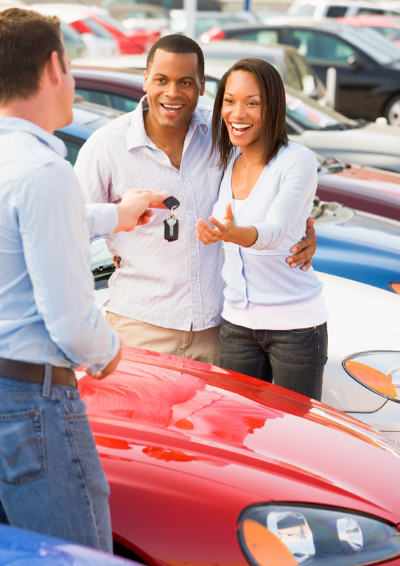 Couple buying a new car
