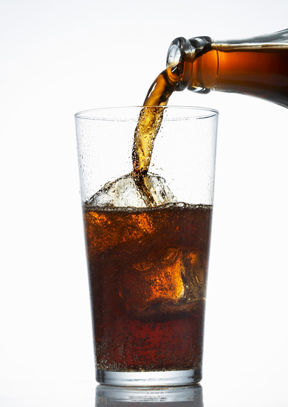 Diet cola pouring into glass
