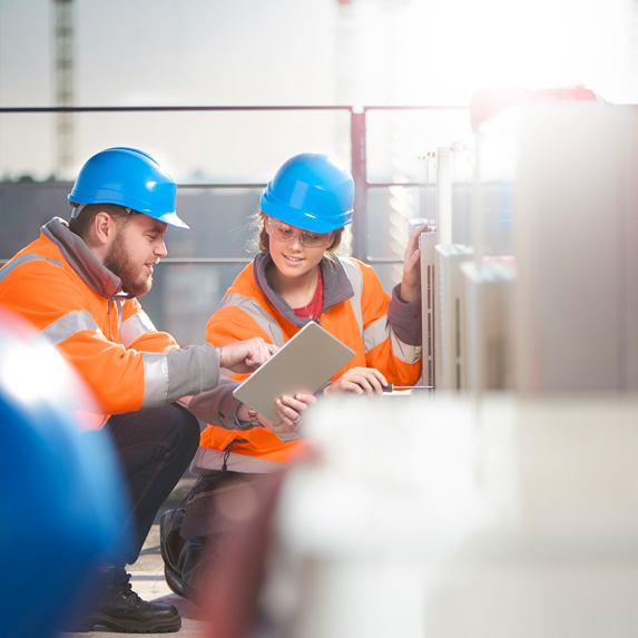 Industrial electrician with a co-worker