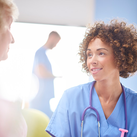 Registered nurse speaking with a patient
