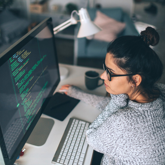 Software engineer using a computer