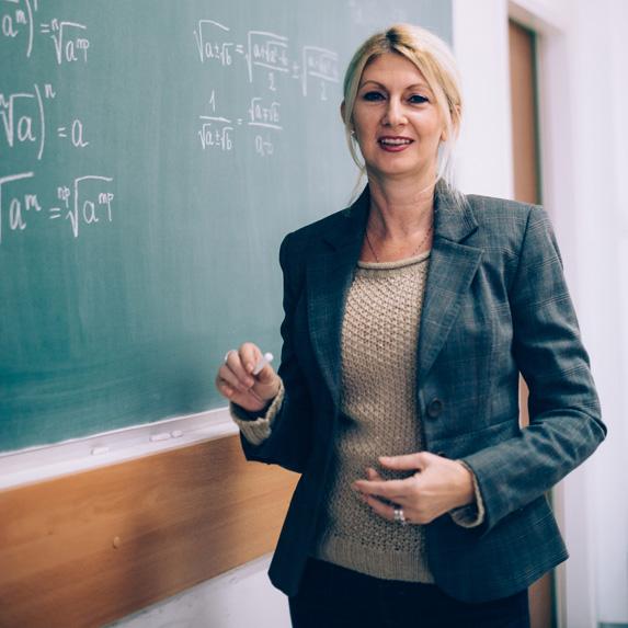 University professor in front of a chalkboard