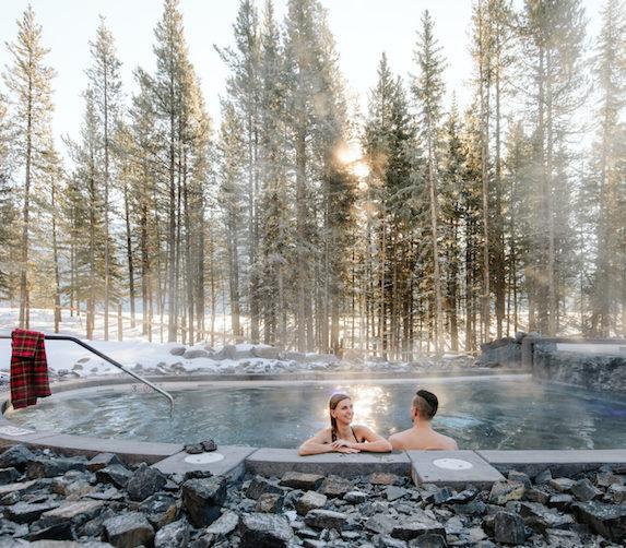 Couple enjoys the outdoor Nordic spa facilities at Lodge at Kananaskis