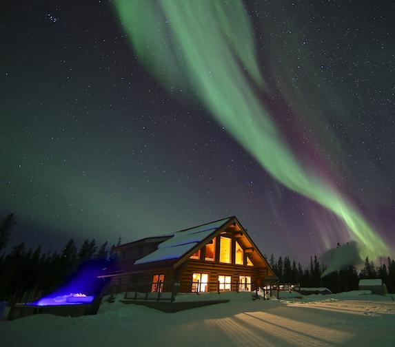The Northern Lights overhead of the Yukon-based spa