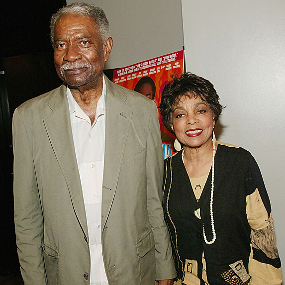 Ossie Davis and Ruby Dee standing next to each other, smiling in formal attire