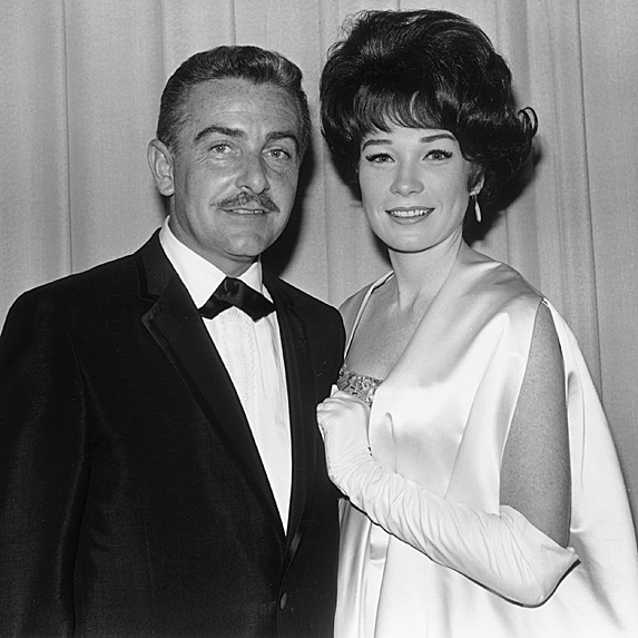Steve Parker and Shirley MacLaine dressed up in a black and white photo, leaning into each other