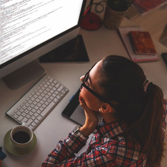 a woman looking at her website