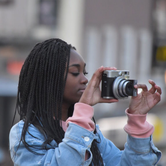 a young woman taking street photography