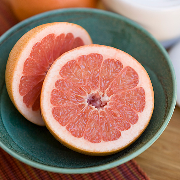 Grapefruit cut in half in bowl
