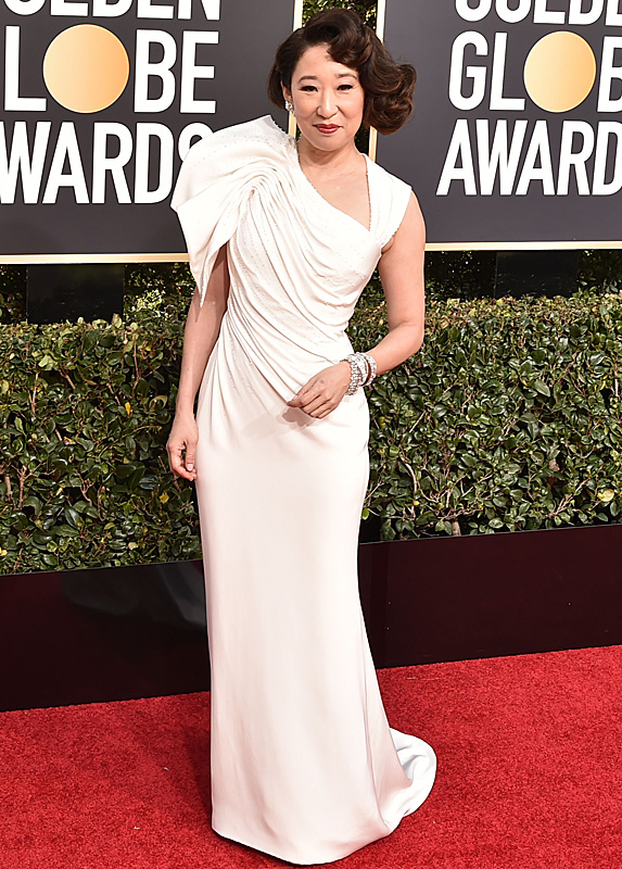Sandra Oh in a dramatic off-white dress