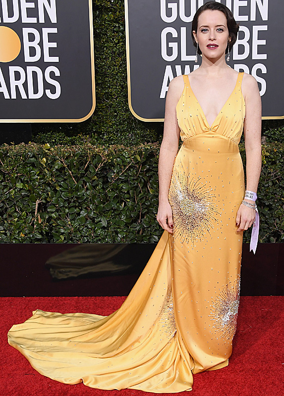 Claire Foy in a yellow dress with sliver embellishments