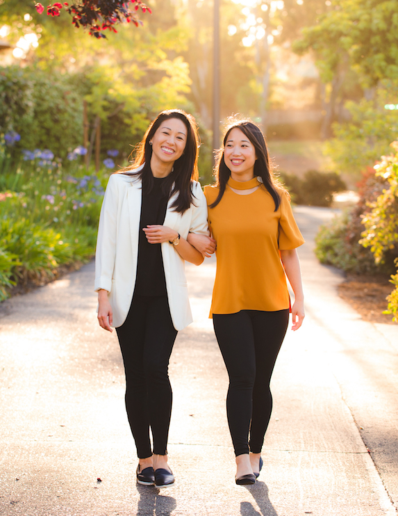 Chemist Confessions founders Victoria Fu and Gloria Wu photographed walking together in a park