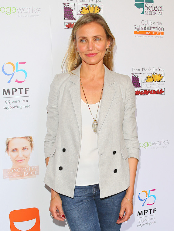 Cameron Diaz dressed casually in jeans and a blazer while posing for a photo at an event