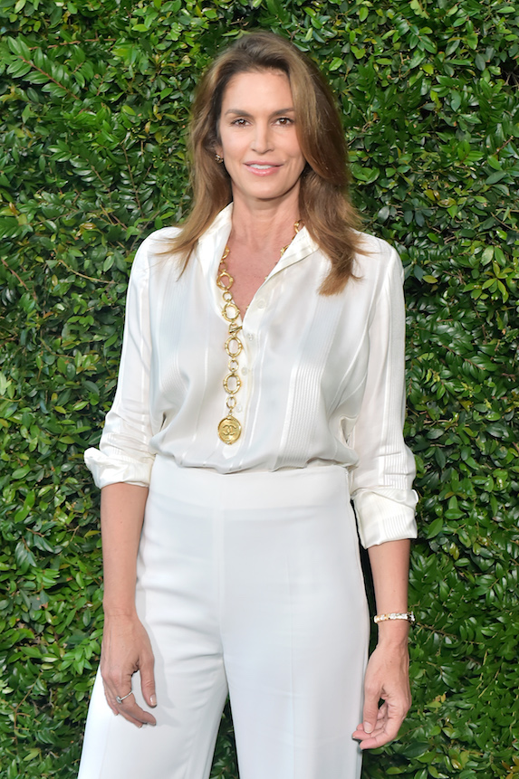 Cindy Crawford poses while attending an event in 2018