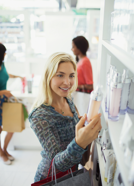 Blonde woman shopping for beauty products