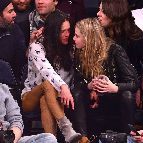 Cara Delevingne and Michelle Rodriguez at a basketball game