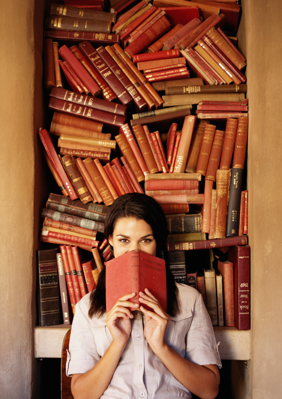 Woman surrounded by books
