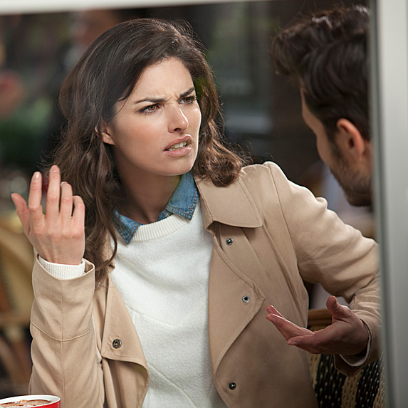 Woman looking thoroughly irritated by man