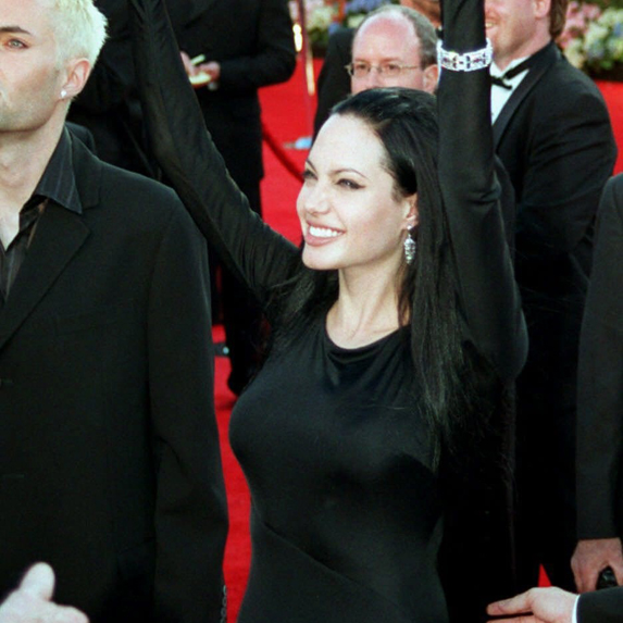 Angelina Jolie waves to the crowd on the red carpet