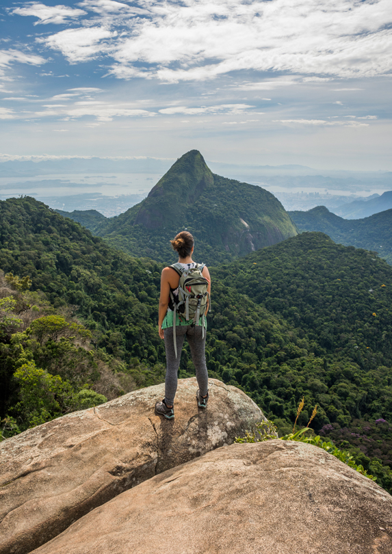 Solo female traveller looking at mountain