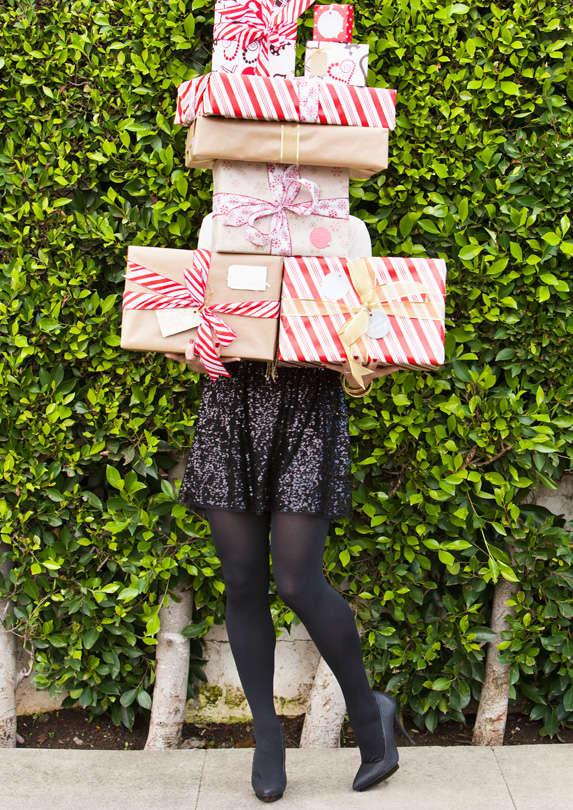 Woman holding a bunch of gifts