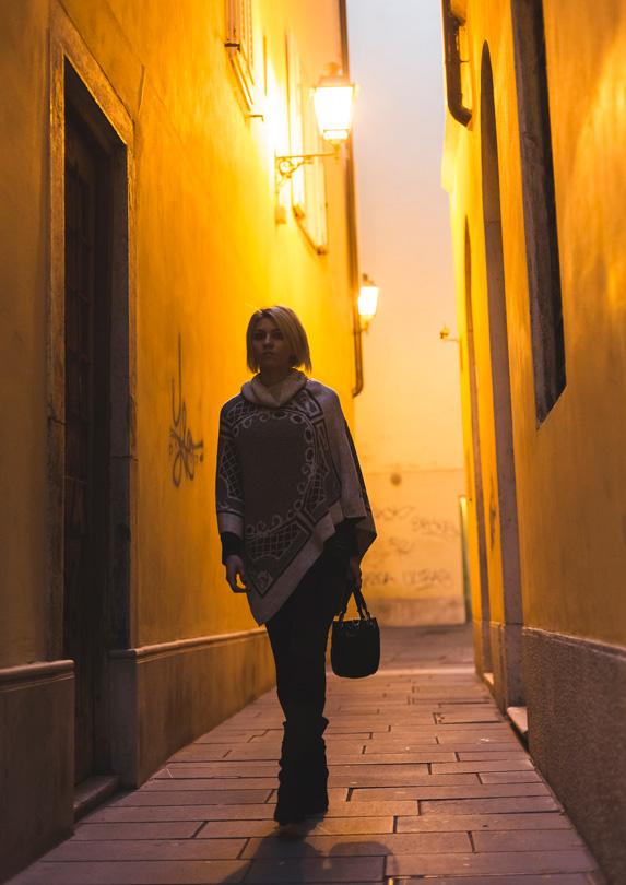 Woman walking in dark alley