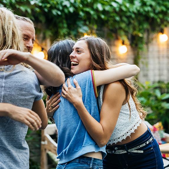 People hugging in an outdoor space