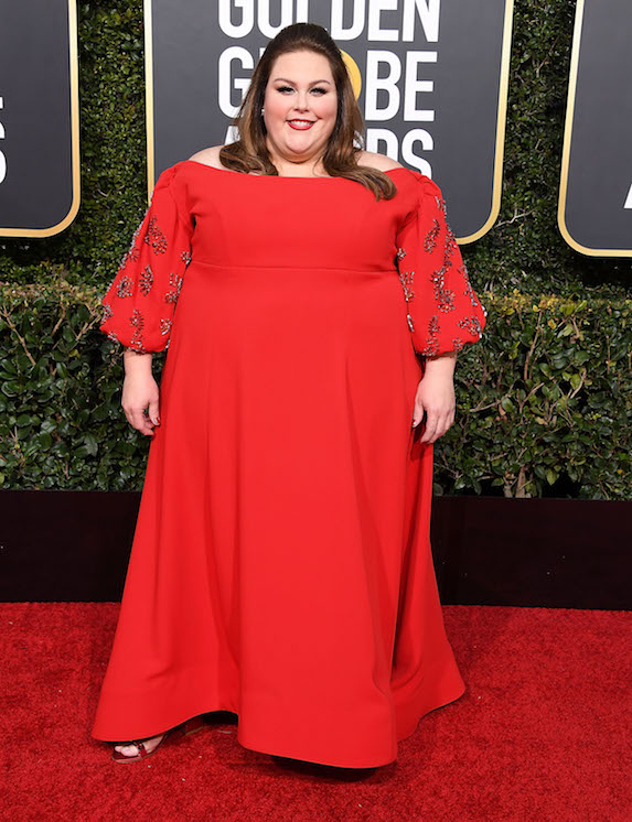Chrissy Metz wears a bright red gown on the Golden Globes red carpet