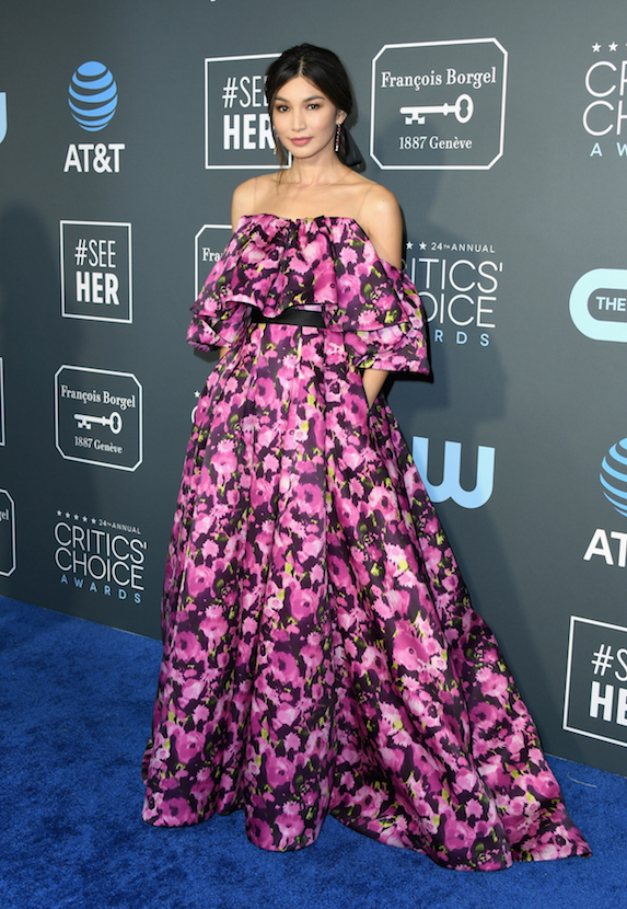 Gemma Chan wears a floral-print gown to the 2019 Critics' Choice Awards