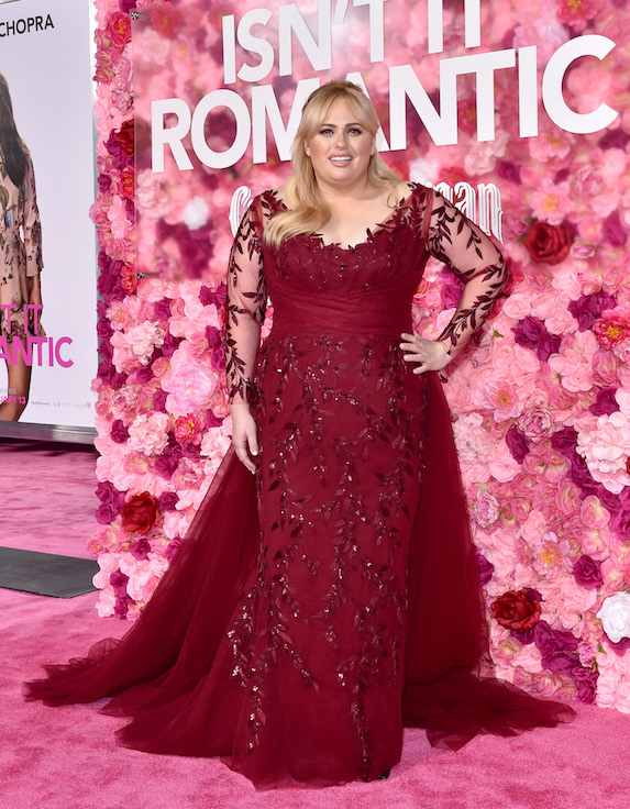 Actress Rebel Wilson wears a red gown to her film premiere