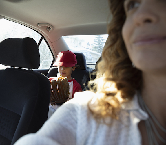 Mother drives son to baseball practice