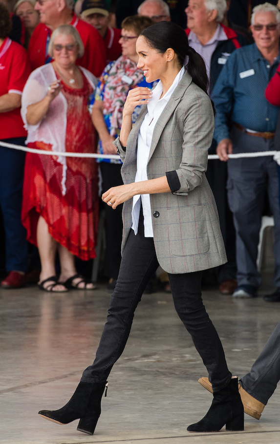 Meghan Markle wears a casual ensemble featuring a blazer