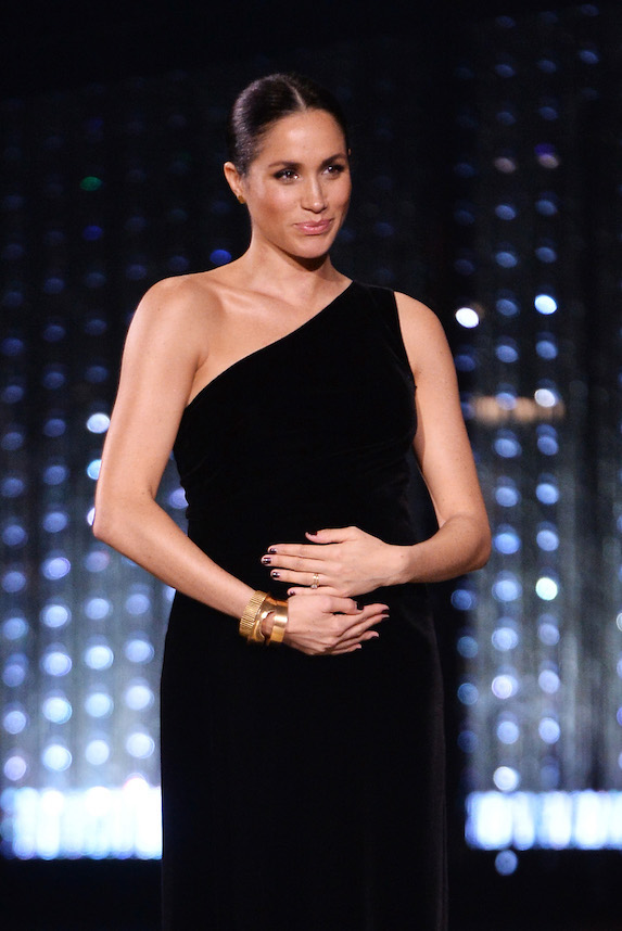 Meghan Markle dons a black gown at an event