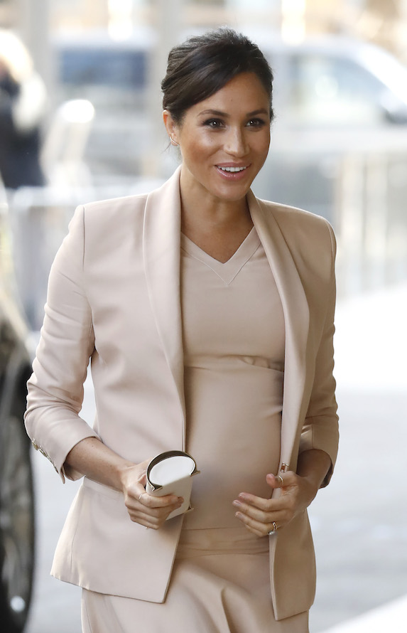 Meghan Markle wears a pink outfit