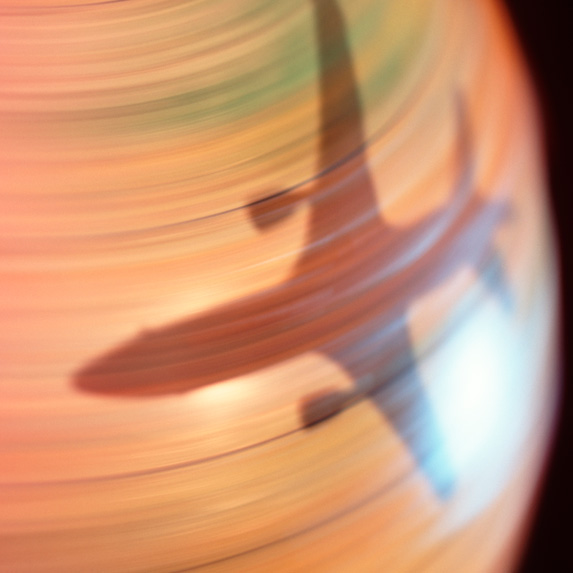 Shadow of a plane on a spinning globe
