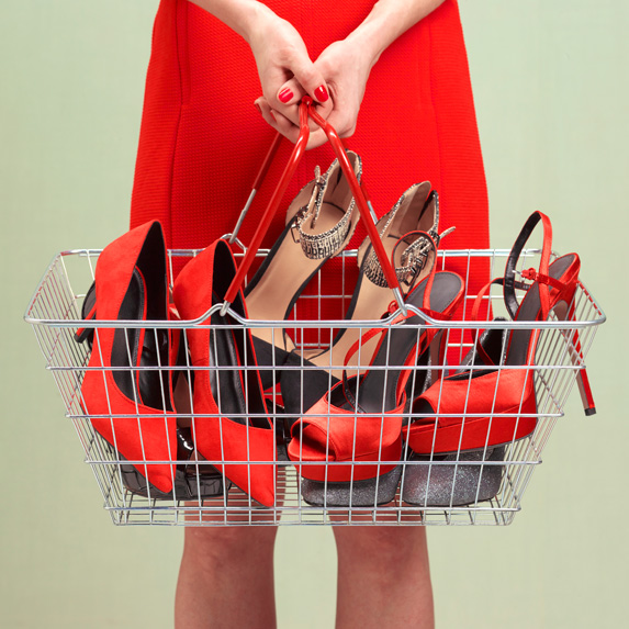 Woman holding a basket of shoes