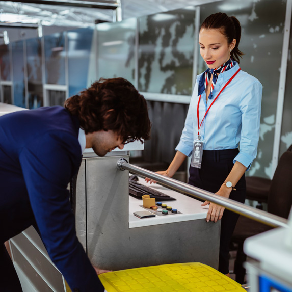 Passenger service agent helping guest check in