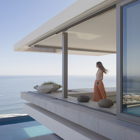 Woman on the balcony of an expensive home